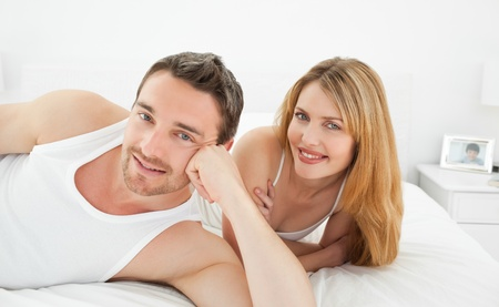 Couple lying down together in their bed Stock Photo - 10218210