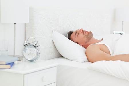 A relaxed man in his bed before waking up Stock Photo - 10213888