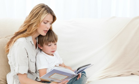 male parent: Mother reading with her son