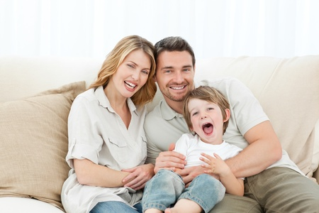 family photo: Happy family on their sofa