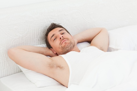 A relaxed man in his bed before waking up Stock Photo - 10214529