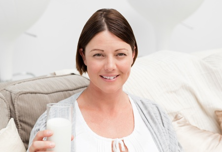 Pregnant woman drinking milk photo