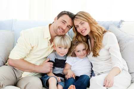 Cute family on the sofa Stock Photo - 10218987