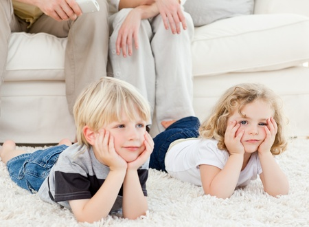 Adorable family watching tv Stock Photo - 10207122