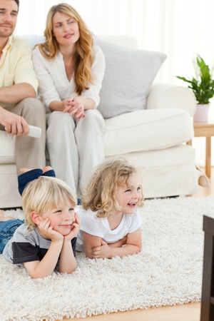 Adorable family watching tv Stock Photo - 10219442