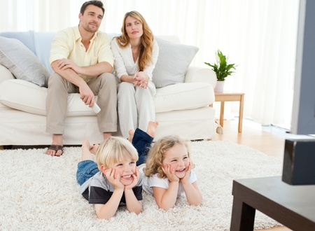 Adorable family watching tv Stock Photo - 10207743