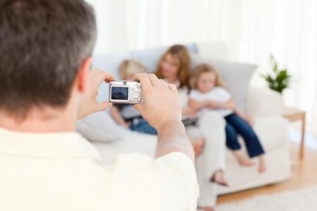 Man taking a photo of his family Stock Photo - 10214507