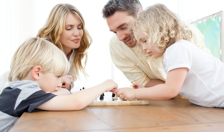 Family playing chess on a table photo