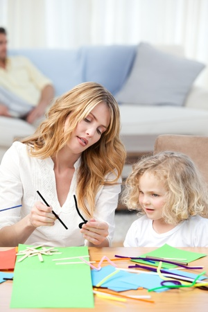 Woman and  her daughter cutting paper Stock Photo - 10219148