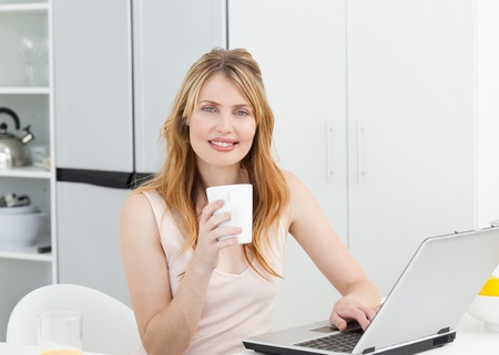 Woman drinking coffee in her kitchen Stock Photo - 10207529