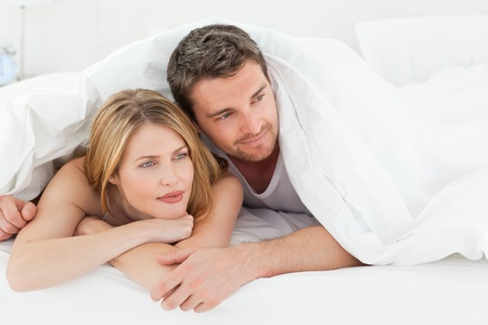 Lovely couple hugging  in their bed photo