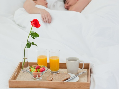 Lovers sleeping after having breakfast photo