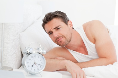 A man in his bed before waking up photo