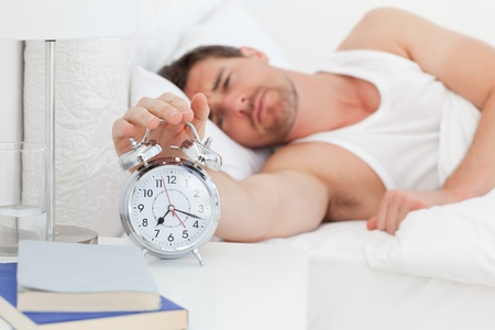 An unhappy man in his bed before waking up Stock Photo - 10170339