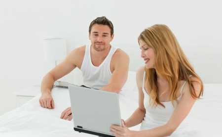 Lovers looking at the laptop  photo