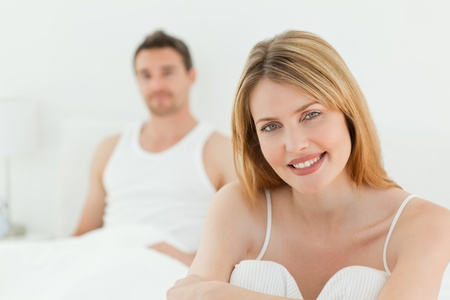 unbend: Beautiful woman looking at the camera with her husband Stock Photo