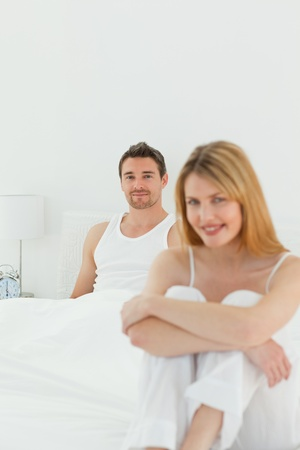 Beautiful woman looking at the camera with her husband Stock Photo - 10212403