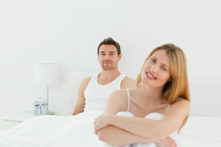 Beautiful woman looking at the camera with her husband photo