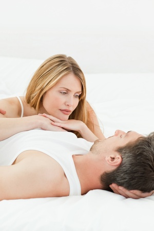 Lovely Couple lying down together in their bed at home Stock Photo - 10214862