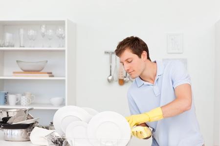 Man washing dishes  photo