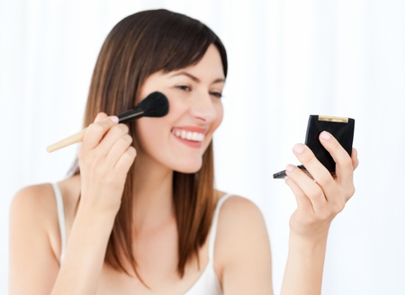 Beautiful woman putting on Make up photo
