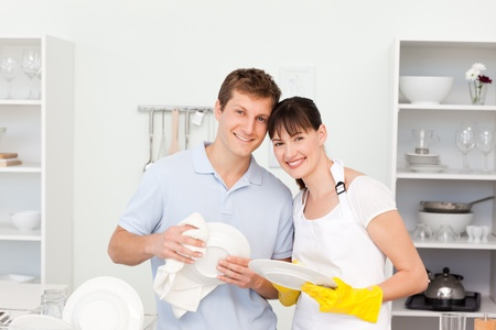 washing dishes: Couple washing dishes together