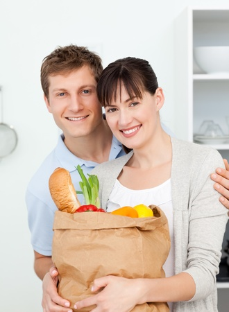 Lovely couple looking at the camera with their shoping bags Stock Photo - 10217505
