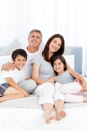 Family  lying down on their bed Stock Photo - 10214277