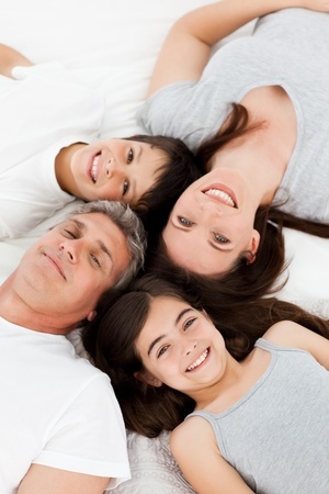 Family  lying down on their bed Stock Photo - 10172316