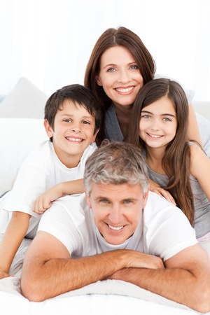 Happy familly looking at the camera photo
