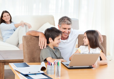 Family looking at the laptop Stock Photo - 10207575
