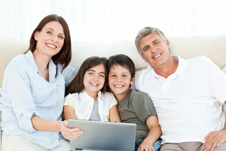 Pretty family looking at the camera at home photo