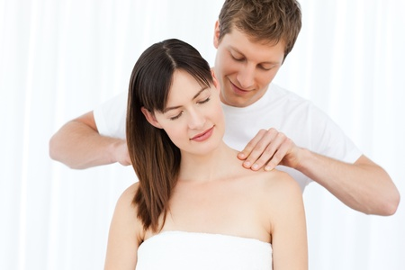 massaging: Man giving massage to his wife Stock Photo
