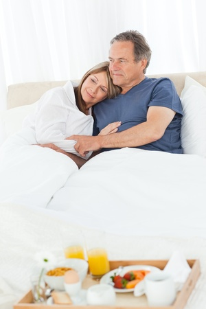vexation: Woman having a headache on her bed Stock Photo