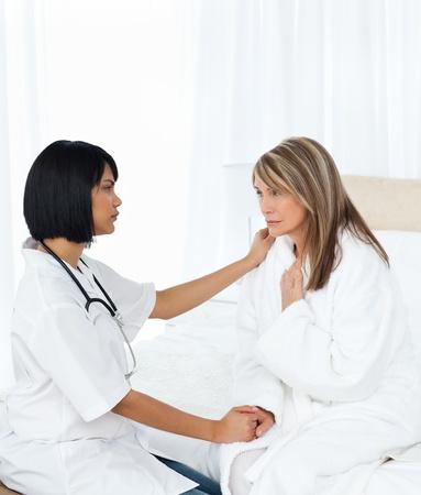Senior talking with her nurse photo