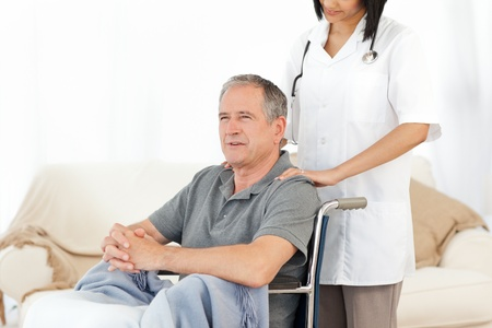 Nurse with her patient looking at the camera Stock Photo - 10218862