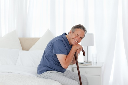 hospital: Man with his stick at home