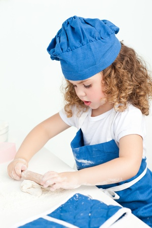 Little girl baking in the kitchen at home Stock Photo - 10220420
