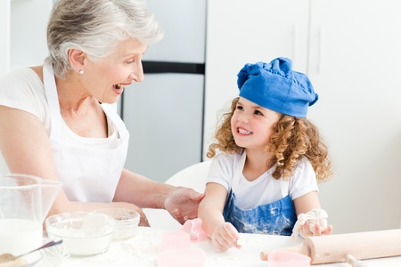 A little girl baking with her grandmother at home Stock Photo - 10219641