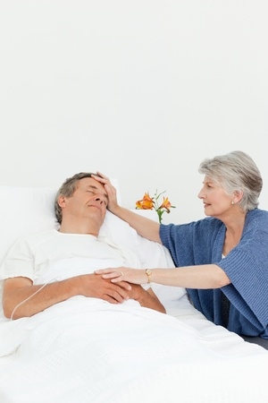 hardy: Mature woman taking care of her husband  Stock Photo