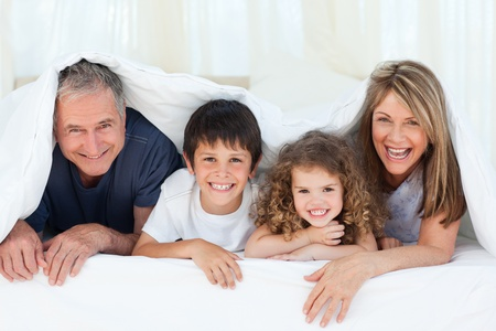 Family in their bedroom looking at the camera at home Stock Photo - 10255496