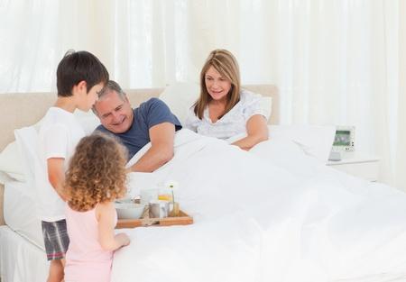 Family having breakfast at home photo