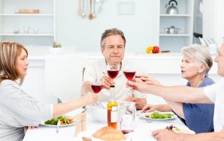 Retired friends toasting together at home photo