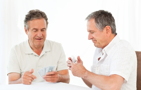 Men playing cards on the table photo