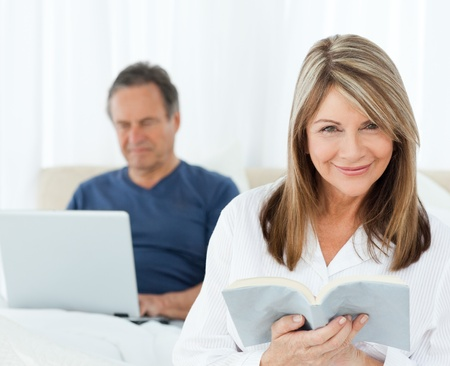 Woman looking at the camera at home photo