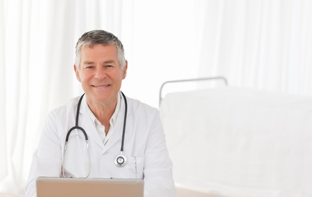 Pretty nurse taking the heartbeat of her patient Stock Photo - 10206350