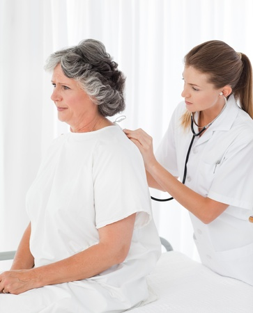 Nurse putting a drip on the arm of her patient Stock Photo - 10207304