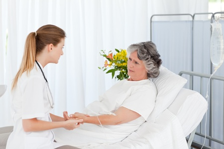 family practitioner: Nurse taking care of her patient