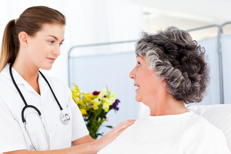 Mature woman talking with her nurse Stock Photo - 10218721