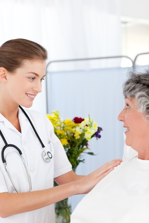 hospital: Mature woman talking with her nurse Stock Photo